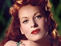 Maureen O'Hara is an Irish film actress and singer. The famously red-headed O'Hara has been noted for playing fiercely passionate heroines with a highly sensible attitude. She often worked with director John Ford and long-time friend John Wayne.