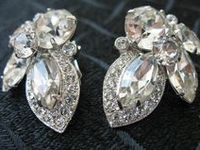 Known for its use of Swarovski crystals & colored stones,  superior craftsmanship & attention to detail. It was one of the most highly regarded costume jewelry manufacturers in the 1930s and '40s. Eisenberg & Sons actually began as a women's clothing company in 1914 when Jonas Eisenberg founded the firm. Jewelry was used to decorate the clothing to make it more appealing to customers. The jewelry kept getting stolen because it was so attractive.