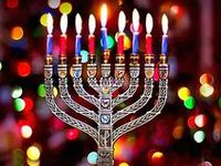 """Hanukkah, oh Hanukkah, come light the menorah Let's have a party, we'll all dance the hora Gather 'round the table, we'll give you a treat Dreidles to play with and latkes to eat."""