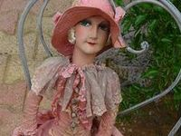 I love dolls of the 20's and 30's, particularly French boudoir dolls and hat stands