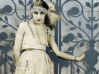 │1920s flapper evening dresses │ loose shift dresses that allowed a lot of freedom for dancing │ drop-waist │often featured heavy beading and uneven hemline │ dancing dresses │20s vintage fashion │