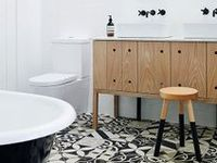 Tubs, sinks, faucets, tile & more. Inspiration for a sleek luxurious bathroom