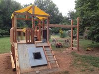 Our concrete storm shelter was an eye sore so we built this from oak & cedar with my plans.  Includes climbing wall & rope option, slide over smooth concrete, ladder beside entrance, 10' monkey bars, chalkboard, etc.