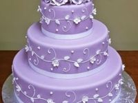 Lavender and mauve - with shades of deeper hues - and accents of gray and cream -- add silver accompaniments!