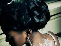 A collection of formal and unique hairstyles to suit brides of all styles or races. Ideal bridal wedding hair consists of: 1. High and structured curly/wavy updos. For tiara placement. 2. Sideswept bangs. 3. Loosely curled tendrils. 4. Lower pinned bun in back of hair. For veil placement.