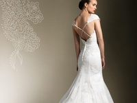 It is a well known fact that your wedding guest will see you quite a bit of your back view. Here are some open and low back wedding dresses.