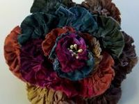 I AM SUCH A MAJOR FAN OF ALL TYPES OF FABRIC FLOWERS. I JUST CAN'T STOP PINNING THEM. THERE IS A LOT OF CRAFT TALENT OUT THERE.