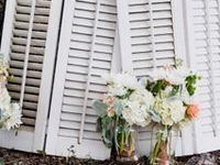 Wedding decor and wedding signage for your big day. Browse tissue paper garland, paper poms, chalkboard signs, vintage doors and windows, mason jars, books and lanterns for your decorative look.