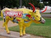 """""""Cow Parade is an international public art exhibit that has been featured in major world cities.  Fiberglass sculptures are decorated by local artists, and distributed around the city.  This concept has it's origins in Zurich, Switzerland beginning in 1998 by director Walter Knapp."""""""