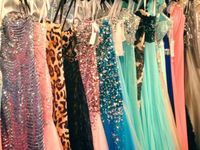 A collection of long prom and bridesmaid dresses.