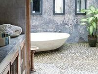 Simple with a splash of color, with interesting tiles and raw wood elements