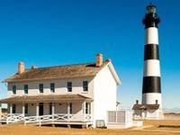"""The menacing waters of """"the graveyard of the Atlantic"""" were a crucial aspect in the birth of the Outer Banks lighthouses. Outer OBX lighthouses include Currituck Beach, Bodie Island, Roanoke Island Marshes, Bodie Island and Cape Hatteras."""