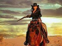 should've been a Cowboy  I should've learned to rope and ride  I'd be wearing my six-shooter  Riding my pony on a cattle drive
