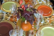 Thanksgiving Theme Tables / Every year I reinvent our Thanksgiving table with different dishes, flower arrangements and table coverings. Sometimes it just means seeing what you already own in a new way. A small budget, wrapping paper, and planning can create a memorable table. I even ask my guests to dress for the theme colors. Look at this tables by artist Harriete Estel Berman.