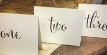 Table Numbers / One, two, three, four; let your guests fall in love with the perfect finishing touch to your wedding reception. All designs created exclusively by Persnickety Invitation Studio, and most are entirely customizable. Prices start at $4.75 a piece.
