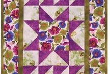 Happy Apple Quilt Patterns / All these patterns were created by Karen, the owner of Happy Apple Quilts.  Instructions are written with beginners in mind, so extra details are included.  All patterns include binding instructions, and all wallhanging patterns also include hanging sleeve instructions.