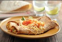 Chicken Enchiladas / Like this dish because it serves as a good template for many quick-dish ideas. I did all the heavy lifting here (no, this is not an excuse for you to skip your workout!) so I could provide all of us with different tastes—a way to enjoy a dish that is usually a deceptively high-calorie one. Keep your metabolism moving with a spicy pico de gallo here, and use fat-free yogurt mixed with lime juice as a fat-free sour cream replacement in your other dishes that may call for whole sour cream.