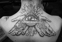 tattoos / piercings.