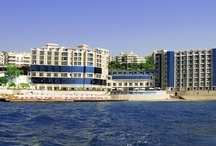 Charisma Hotel  / Welcome to Charisma De Luxe Hotel Kuşadası, where luxury and comfort meet each other. Towering over the Aegean Sea's outstanding view, the Hotel is just a 15 minute walk from Kuşadası's shopping and entertainment venues. You will never feel yourself  that close to the history.