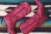 Red Cowgirl Boots / A classic statement in the western wear world: red cowgirl boots. Consider a pair of these ruby-hued beauties a staple in any real cowgirl's closet.