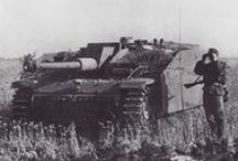 Tanks / A tank is a large, heavily armoured fighting vehicle with tracks and a large tank gun that is designed for front-line combat.