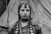 "Gypsy: Roma, Sinti, Gitano People / The once enigmatic dark people of Europe, the ""Gypsies,"" or Roma (or Rrhom) or Romani. Of South Asian Indian origin (circa 10th through mid-11th centuries AD), today there are at least 5 million and as many as 10 million Romani worldwide--in Europe, the US, and Brazil--of ethnic groups Boyash, Calo, Chikkenner, Churara, Kalderashi, Kale, Lowara, Machwaya, Manushe, Mechkari, Sinti, Tsigane, Ursari, etc.  I've tried to find and use only authentic pictures of real Roma people."
