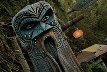 Tikis and Totems / A collection of wood carved tikis and totems