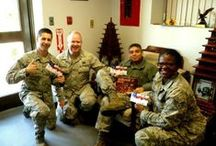 Troops with Cell Phones For Soldiers Calling Cards / Troops proudly displaying calling cards donated by Cell Phones For Soldiers allowing them to connect with their loved ones for free.