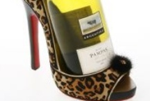 Wine Bottle Shoe Holder / If you know someone who loves shoes and wine, why not give this shoe wine bottle holder?  The Wine Shoe is the most glamorous wine bottle holder you could set your eyes on.  Made from resin and hand finished and painted this wine bottle holder will set off any Kitchen, sideboard or dinning table. Why not make it a pair of Wine Bottle Holders! Each Wine Shoe holds a full size bottle of wine. The perfect gift for shoe and wine lovers! http://www.specialoccasionsgiftware.co.uk/