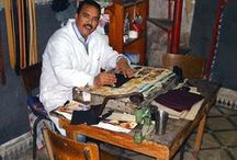 Leather Project ~ North Africa / In the mountains of North Africa, the Berber artisans of the Leather Project skillfully craft leather scraps from a furniture and upholstery company into smooth purses and book marks. This time-honored tradition helps them to earn money that supplements their jobs as subsistence farmers and shepherds.