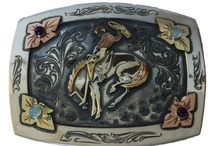 Cosmic Cowboy / The Cosmic Cowboy Collection is a contemporary line of solid sterling, hand engraved accessories designed around a fun cast of characters. Below you can find the Cosmic Cowboy himself, along with friends Johnny Bones, Penny Annie, Cross Roads, Kicker Boot, Mary Butterfly, and the outlaw Dusty Roads. As each piece is built to order, no two are identical.