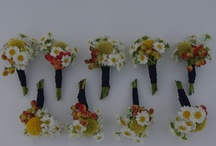 WEDDINGS -  Boutonnieres / A collection of boutonnieres.