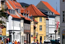 Denmark / The Kingdom of Denmark is located in northern Europe. It's the smallest of the three Scandinavian countries. The other two are Sweden and Norway. Nearly five and a half million people live here. It is my husband's homeland.
