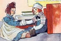 Raggedy Ann / Raggedy Ann is a character created by American writer Johnny Gruelle (1880–1938). Raggedy Ann is a rag doll with red yarn for hair & has a triangle nose. Gruelle created the Raggedy Ann doll in 1915 for his daughter Marcella. The doll  was introduced to the public in the 1918 book Raggedy Ann Stories. A sequel, Raggedy Andy Stories (1920) introduced the character of her brother, Raggedy Andy. The dolls were originally handmade. Later, PF Volland (& eventually others) made the dolls.
