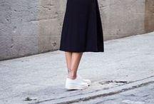 Urban girls sip tea in skirts