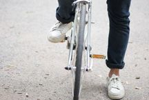 Urban boys ride bicycles in chinos