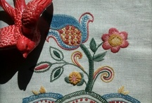 crewelwork / crewel embroidery / Crewel embroidery, or Crewelwork, is a decorative form of surface embroidery using wool and a variety of different embroidery stitches to follow a design outline applied to the fabric. The technique is at least a thousand years old.