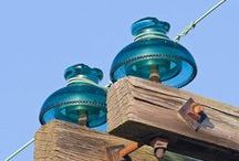 Vintage Insulators / Insulators were used to protect telephone lines, electric power lines, and other applications.  They were made of glass, porcelain and other materials.  The shapes they came in ranged from simple to amazing and collectors are always looking for ones to add to their collections.  Oh, and the colors!  Insulators came in so many colors.  I love to collect, sell and repurpose insulators and share my findings too!