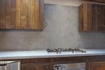 """Concrete Backsplash   Trueform Concrete / Backsplash has the ability to make or break a room. Although it may seem insignificant, backsplash and trim tie the counters to the walls and can really complete the look that you're going for. Like all of our concrete products, backsplash can be custom made (e.g. inlays, decorative designs, etc.). Trueform Concrete can create wall panels, tiles, or the standard 4"""" backsplash for your project."""