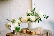 RUSTIC CENTERPIECES / We're suckers for rustic vintage wedding centerpieces with reclaimed wood accents, birch vases, and homespun, heirloom pottery.