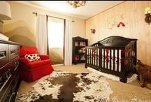 Red & Brown Boy's Western Nursery by Little Crown Interiors / Western nursery with warm reds and browns, designed by Little Crown Interiors in Southern California.