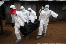Ebola : Safety Gear & Health Practices during Emergency Responses / Pinning up pictures of where it seems like Safety Gear is insufficient or incorrectly used (?).  Or when Health practices can be improved or considered in crisis situations.    Note : I'm not an expert and am pinning the pictures up with comments as a learning about Pandemic emergency response.