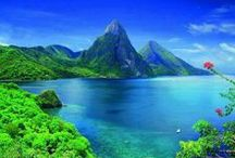 St. Lucia / St. Lucia is the sort of island that travelers to the Caribbean dream about - a small, lush tropical gem that is still relatively unknown. In natural beauty, St. Lucia seems like an island plucked from the South Pacific and tucked into the Caribbean. Its dramatic twin coastal peaks, the Pitons, soar 2,000 feet above the sea, sheltering magnificent rain forests where wild orchids, giant ferns and birds of paradise flourish...