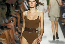 Michael Kors Spring 2011 RTW / one of my favorite shows of all time- long flowing skirts, camel colored leather strappy sandals (flats and wedges) with thick gray socks, long sleeved tees & chunky knit sweaters, belts, straps, hats, floral/garden inspired textures/colors, perfectly suited models Isabeli Fontana, Karolina Kurkova
