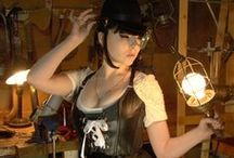 Steampunk Fashion Clothing / Steampunk Women Fashion with gear, and a little Goth thrown in here and there. I love a woman in a dress. I love the fashions, gizmos, tinker gadgets, and craftsmanship. Women can still be sexy and alluring, even with 4 layers of clothes on. Some women understand this, some do not. Anyway, there are some nice outfits here for the Ladies, and beautiful women for the guys. / by Rocketfin Hobbies