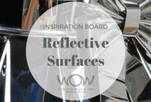 2018 Inspiration: Reflective Surfaces / Catch our eye, make us catch our breath.  The joy of light brought to life. Create a work of art that adorns the body and plays with light and shine. Consider everyday items, plastics, metals, fabrics, mirrors … materials that glimmer, sparkle and glow.