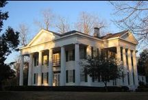 Southern Plantation Homes / Based on the gracious antebellum manors of the deep south, Plantation house plans reflect a combination of rural practicality & Neoclassical, Greek Revival, & Italianate styles. The very picture of southern hospitality, Plantation style house plans welcome visitors with soaring columned porches & galleries that may extend across the front or wrap around all four sides of the home. Tall French windows swing in to let breezes cool the interior, while wooden shutters filter the southern sunlight.  / by Margie Forrest
