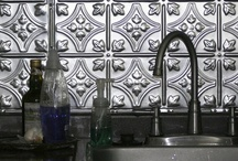 Backsplash / Adding a backsplash to your kitchen and/or bath can add more color, texture and customization to your room. There are many materials, colors and finishes to choose from and endless possibilities to your design. Mix & match to create an even more personal touch to your space. Examples of materials are glass, ceramic, stone, concrete, metal and wood.