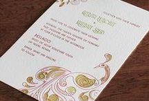 {invitation design} mora / A unique look is found here in the exotic Mora design. This combination of cultures marries the traditional Indian motif with a 20th century French style of art. The two energies combine to create a universal invitation that appeals to couples influenced by romance, art, and design. A proud peacock sits underneath the boughs of a flowering tree to signify an unending love. While honey tones suit Mora well, any color will make this look come alive.
