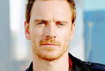 Michael Fassbender / Michael Fassbender mesmerizes in director Steve McQueen's  gripping dramas Hunger (2008), Shame (2011), and 12 Years a Slave (2013).  But never underestimate this man's versatility and range.  In just a few years, he has taken on everything from classic British literary heroes to classic supervillains.  See him as Edward Fairfax Rochester in Jane Eyre (2011), as the android David 8 in Prometheus (2012), as Magneto in Marvel's X-Men films, and in 2015  as the star of Macbeth and Slow West. / by Alesia